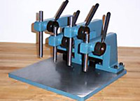 Four Manual Presses Mounted on Special Base